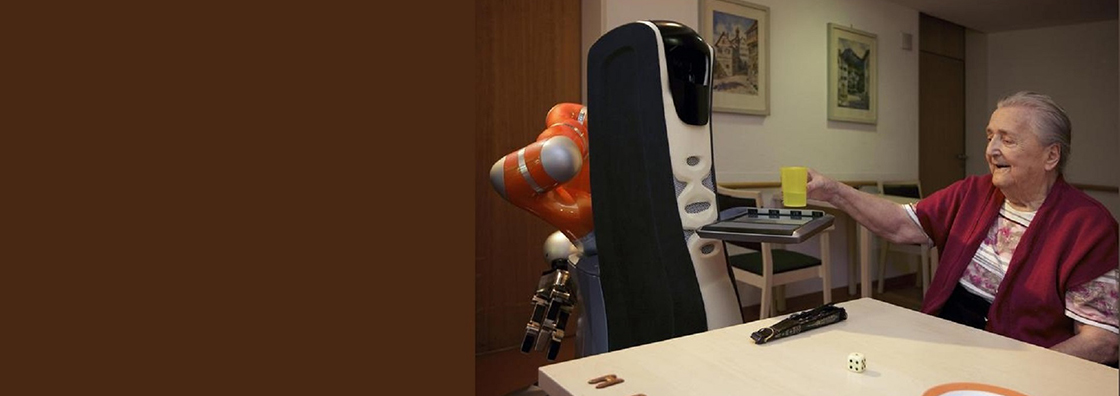Woman using Care-o-Bot in her home
