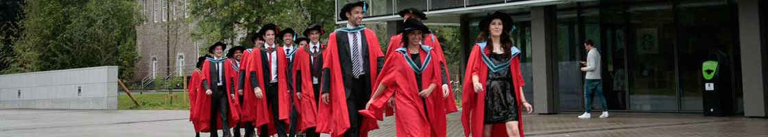 Conferring Outside the Library - Graduates Walking - Maynooth University
