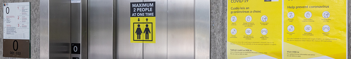 Social distancing signage in Eolas at the lift