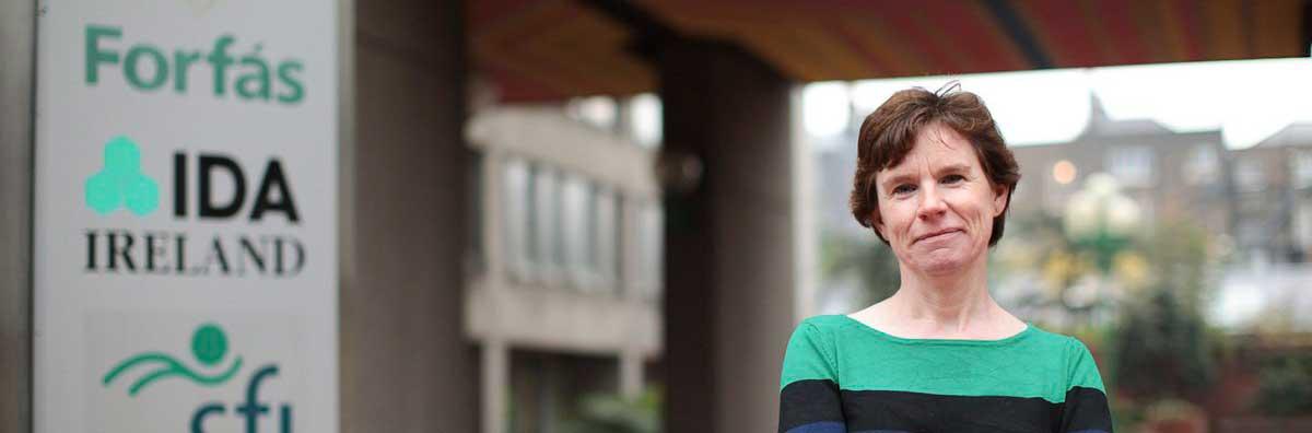Economics - Gerda Dewit Standing Beside a Sign - Maynooth University