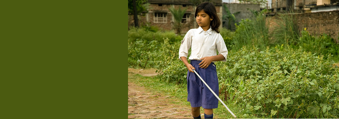 Blind girl using cane