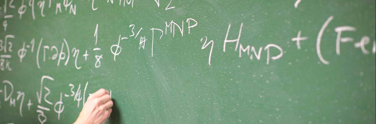 Maths Physics - Lecturer writing Formula on Chalk board- Maynooth University
