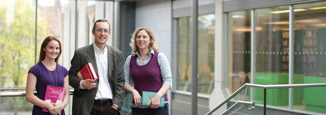 Nua Ghaeilge - Lecturers Holding Books- Maynooth University