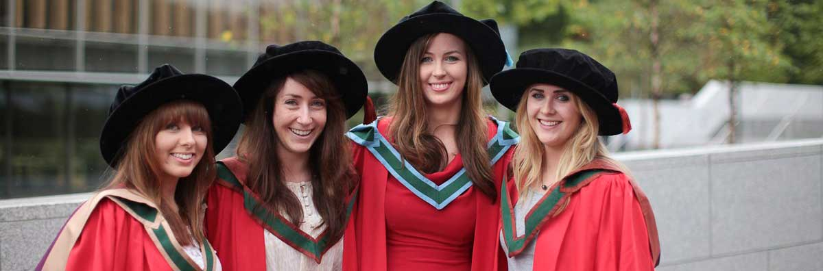 PhD Procession - Female Graduates Outside the Library - Maynooth University