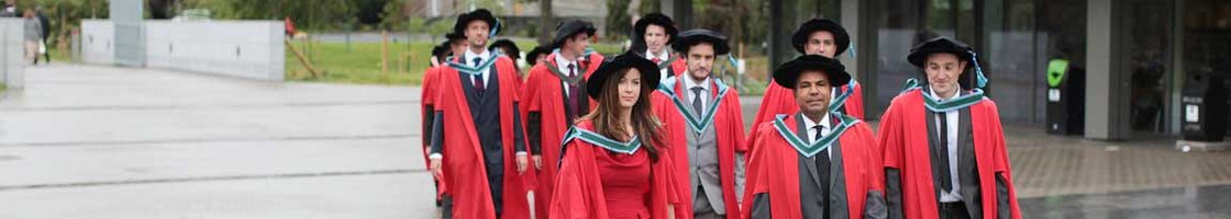 PhD Procession - Graduates Walking Outside the Library - Maynooth University