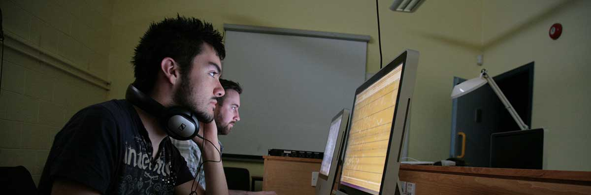 Postgraduate - Male Student Working on Computer - Maynooth University