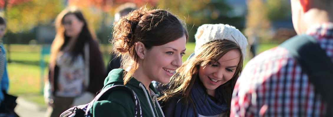 North Campus - Female Students Laughing - Maynooth University