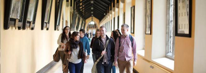 Students Walking Through Cloisters in Maynooth University