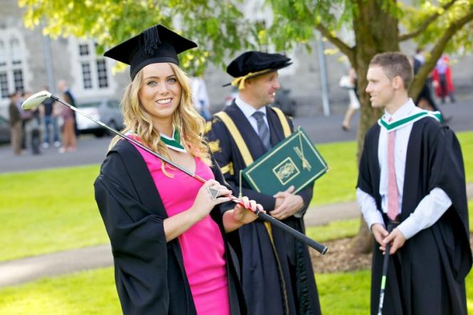 Graduation 2012 - male and female chatting to president  - Maynooth University