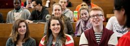 Communications & Marketing - Students in lecture theatre 1120 x 396 - Maynooth University