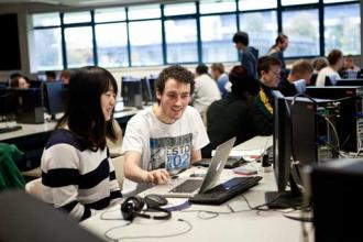 Computer science - Students at a Laptop 500 x 333 - Maynooth University
