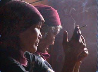 Reindeer veterinarian shares a smoke break with her mother