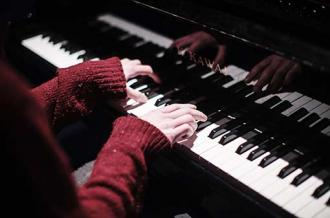 Music - Piano and Red Sleeves - Maynooth University