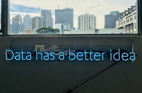 This picture shows a fluorescent sign saying 'Data has a better idea'
