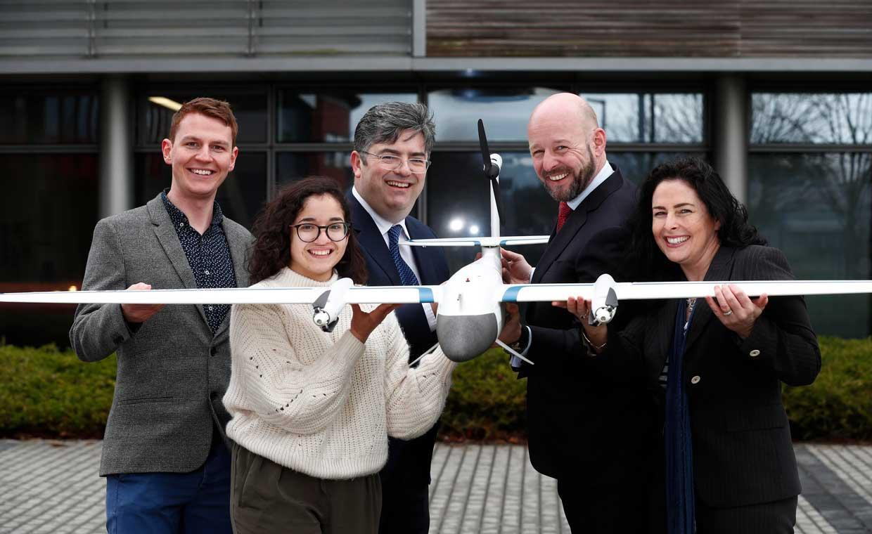 This image shows Intel and Maynooth University Staff and students holding a drone