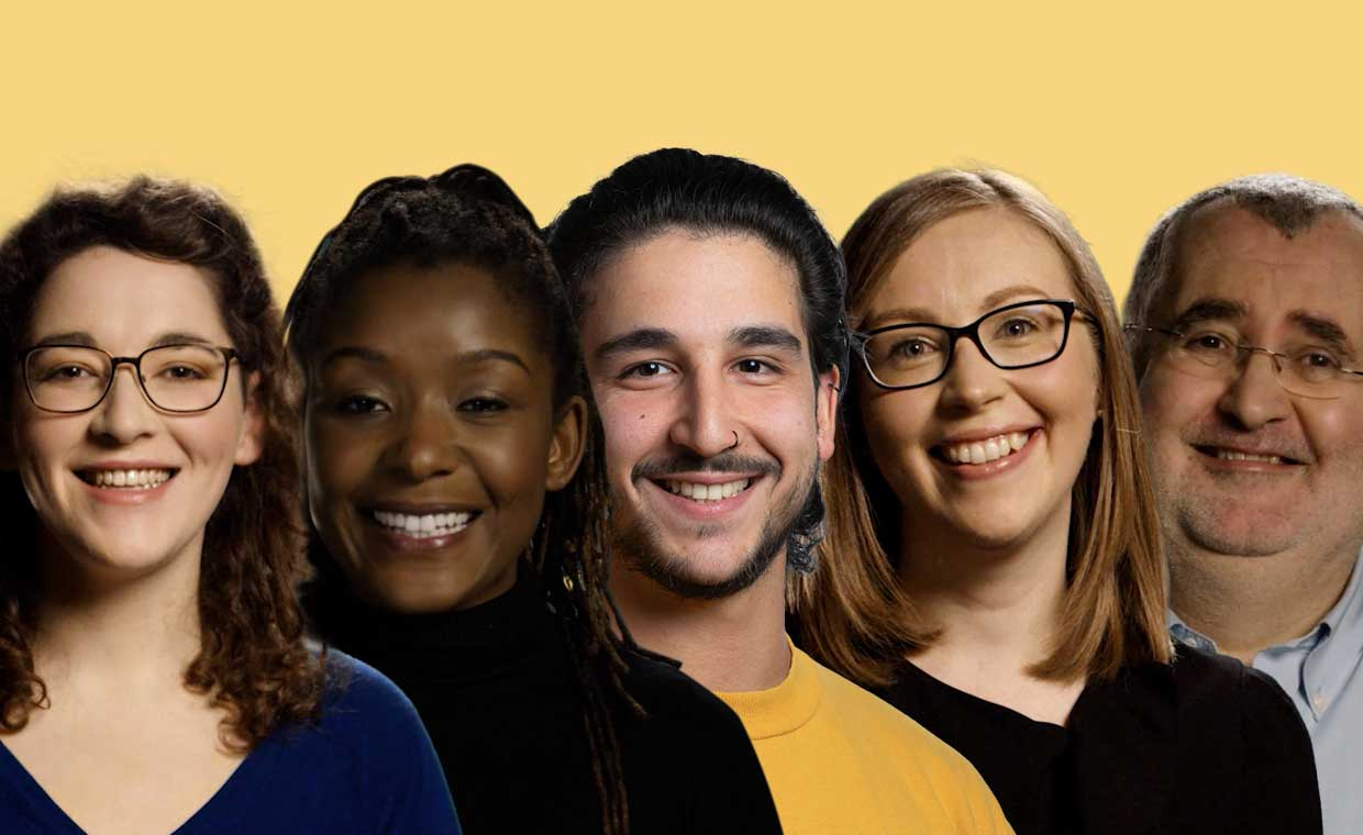 5 people in a row smiling into camera, the background is yellow