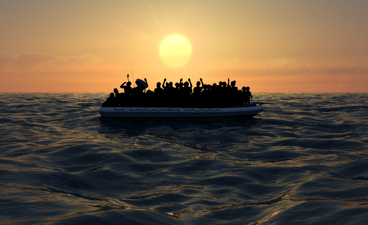 A raft with many people on the sea at sunset