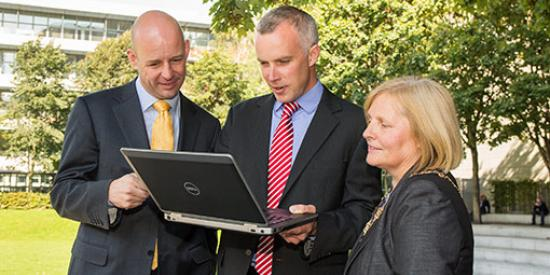 Communications & Marketing - Aero Map Launch Philip Nolan, Councillor Críona Ní Dhálaigh and Justin Gleeson holding laptop - Maynooth University