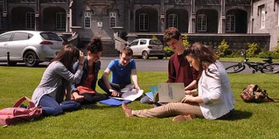Kilkenny Campus - Students sitting on a grass - Maynooth University