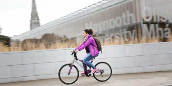 Communications & Marketing - Library sign bike female cyclist - Maynooth University