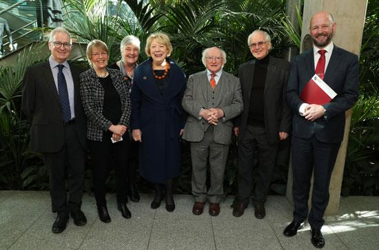 President Michael D Higgins poses with staff at Maynooth University