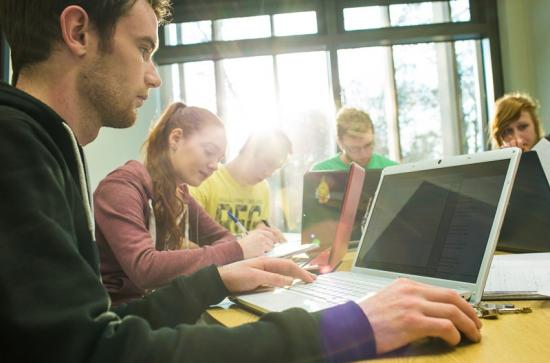 Library - Students on laptops - Maynooth University