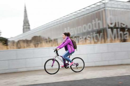 Communications & Marketing - Library sign bike female cyclist - Maynooth University
